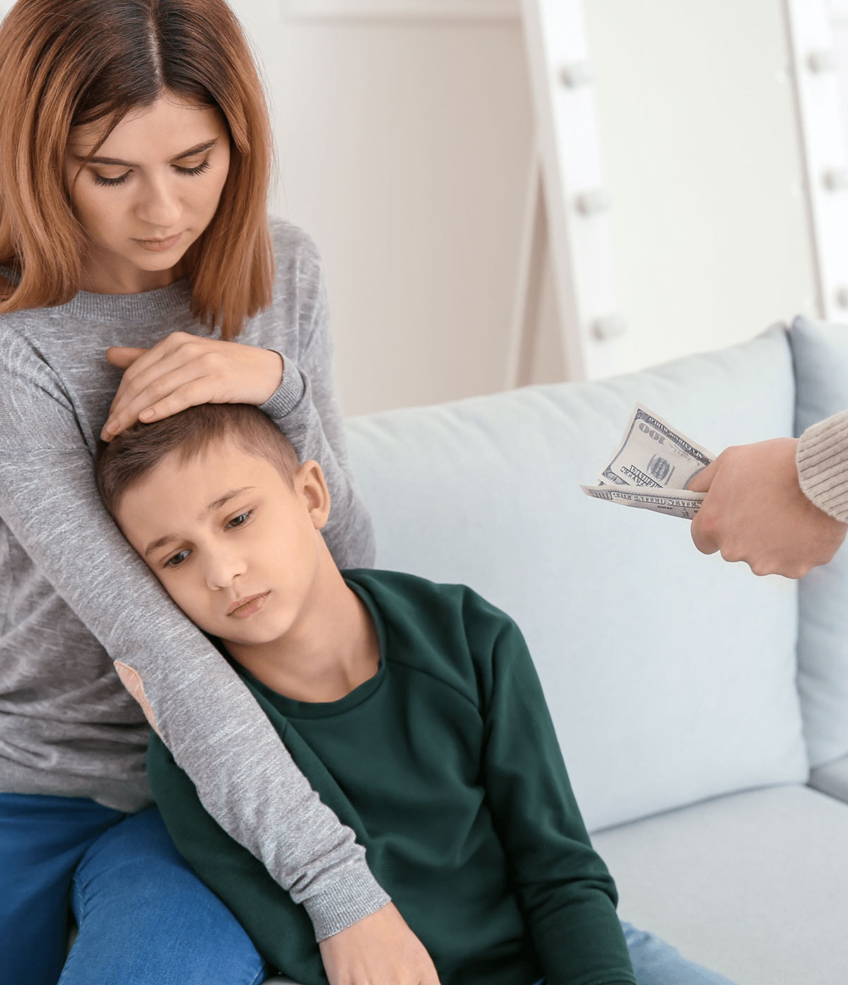 mother and child receiving alimony money