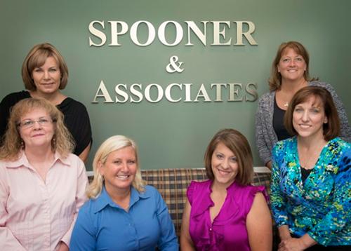 spooner & associates employees sitting in lobby